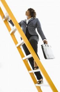 Businesswoman climbing ladder